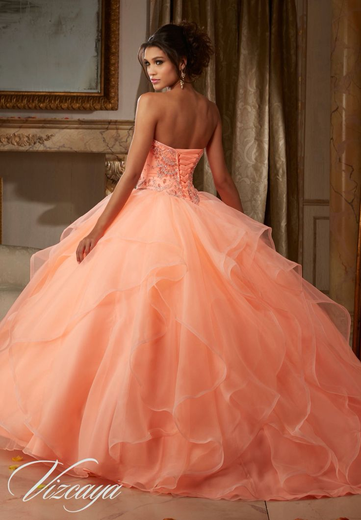 Morilee Vizcaya Quinceanera Dress 89115 GEMSTONE AND CRYSTAL BEADING ON FLOUNCED ORGANZA BALL GOWN Matching Bolero Jacket. Available in Light Aqua, Coral, Champagne, White (Color of this dress): Coral
