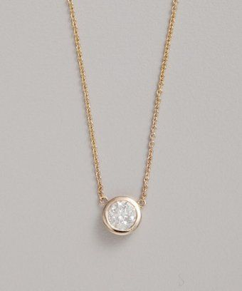 Colette Nicolai diamond and yellow gold bezel solitaire necklace.