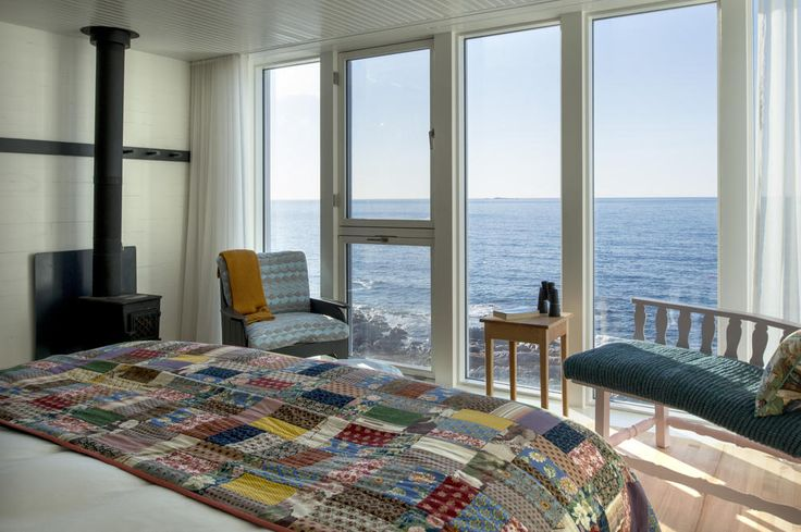 Newfoundland Suites: Spend lazy afternoons in our Ineke Hans- designed Get Your Feet Up reading chairs; on cool days with a wood fire burning and on warm days with the windows open to the fresh ocean air.