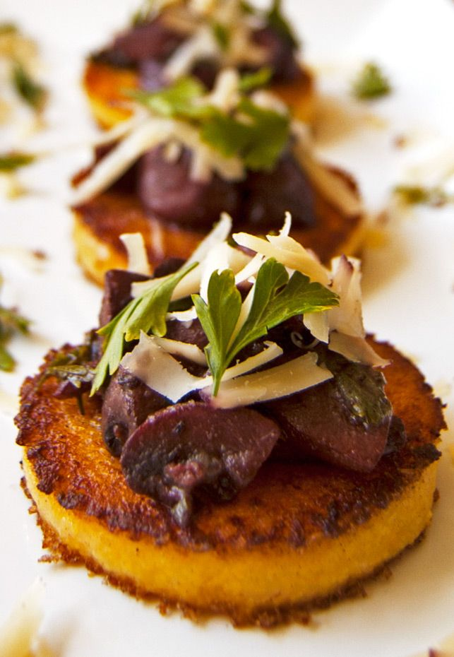 Grilled Polenta Cakes topped with Rich Red Wine Mushrooms and Shredded Cheese {Via 2Teaspoons}