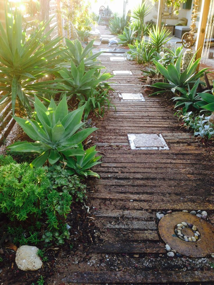 Pallet pathway, left over board from the fence used as a free laid path. recycled pallet wood fence