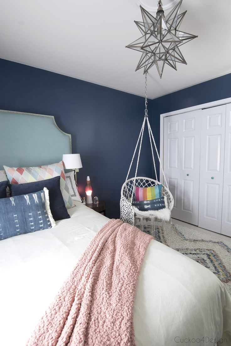 Dark Blue Teenage Girl Room | macrame hanging chair | rainbow pillow | colorful moroccan shag rug | turquoise velvet bed | Moravian star pendant | transitional teen girls room | teenage girl room | preteen bedroom | pre-teen bedroom | #girlsbedroom #teenagegirlsroom #teenager #teenroom via @jakonya