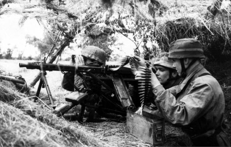 A well camoflaged machine gun position manned by German paratroopers. The MG42 seen here was responsible for the majority of casualties on D-Day and became feared due to its high volume of fire. So successful was this weapon it is still in use to this day some 72 years after it's creation with various Armies of the world.