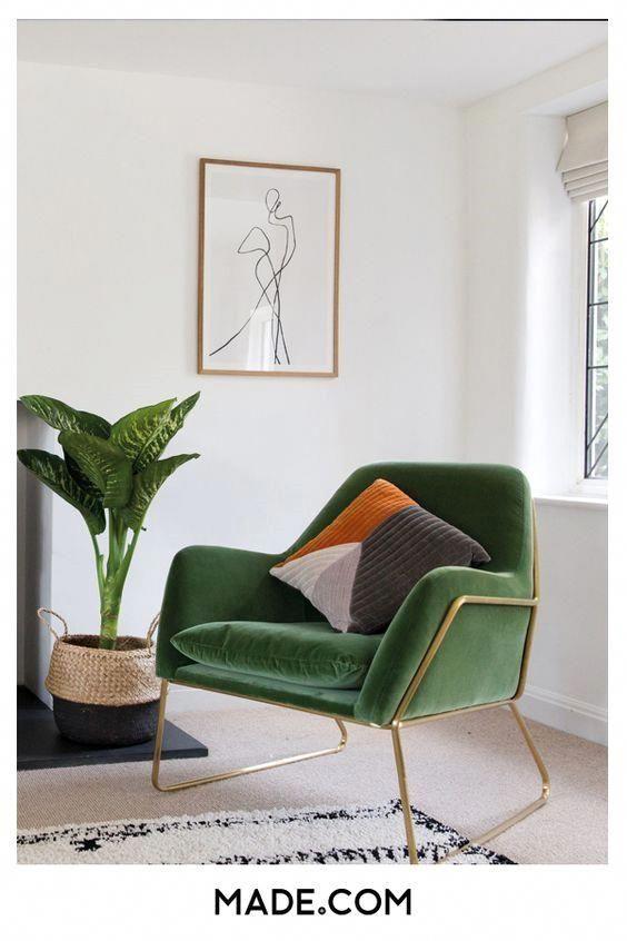 Green velvet and elegant brass details #BrownAndGoldLivingRoom