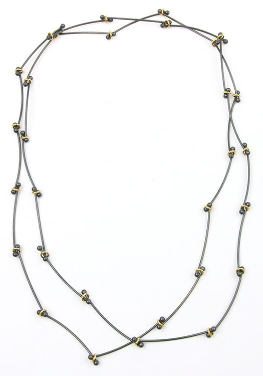 Beautiful long silver necklace with hoops of gold. Handcrafted. By Jan Kerkstra . Marion Pannekoek | The Jewelry Story