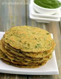 Puda may be sweet or savoury, deep-fried or tava-cooked. Here is a mildly-spiced version of puda made of bajra, rice flour and sprouted moong cooked on a tava with minimal oil. The use of curds for binding gives it a pleasant aroma and flavour. This quick and easy bajra, rice and sprouts moong puda can be prepared as a snack or for breakfast.