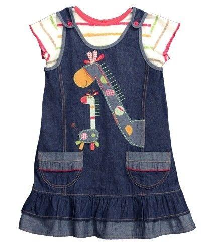 A gorgeous 2 piece pinafore style denim dress set with a giraffe appliqué and embroidered stitching, comes with matching stripe top. This product is certified Fair Trade Made from 100% fair trade cotton – machine washable