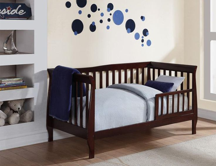 This solid-wood toddler bed from Baby Relax is both safe and sophisticated with its sleigh-style design and details!
