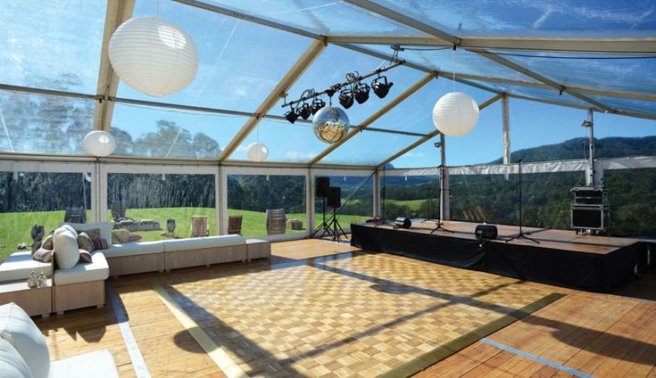 Dancehall with band stage was designed in a clear walled and roof marquee with parquetry dance floor. #KangarooValleyWedding #weddings #YourEventSolution