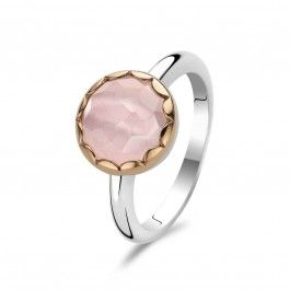 A truly beautiful and eye catching ring featuring a round faceted cabochon stone encircled with rose gold plated edging.