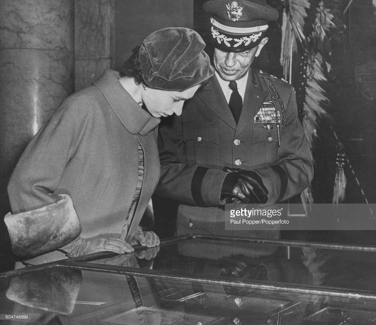Queen Elizabeth II inspects a telegram sent by her father, King George VI, conferring the Victoria Cross on the Unknown Warrior at Arlington National Cemetery, with Major General John G Van Houten at Arlington near Washington DC on October 18th 1957.