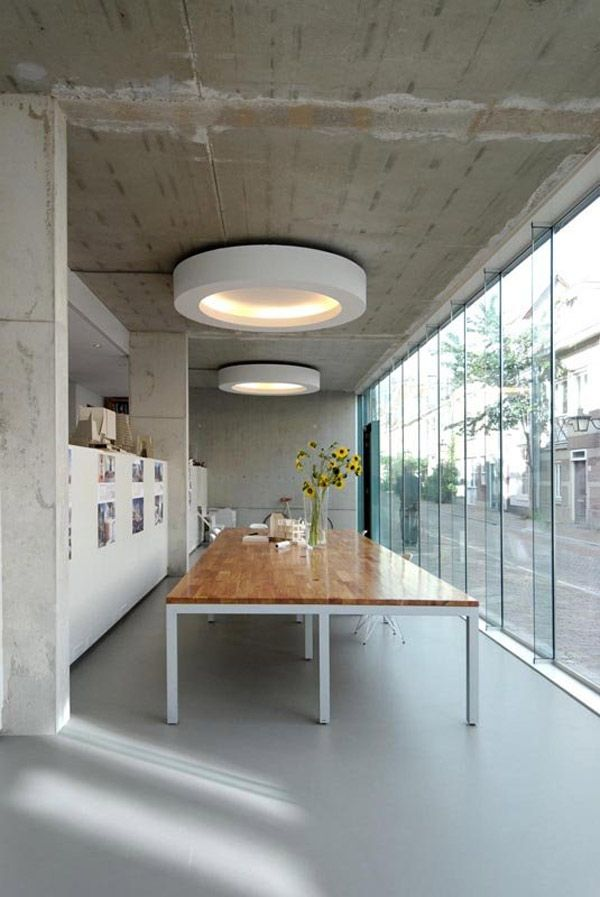Indirect lighting is lighting that does not directly shine down. The indirect lighting in this room is seen in the circular overhead indirect lighting fixtures.