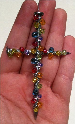 Put beads on wire then wrap around two nails to make a cross