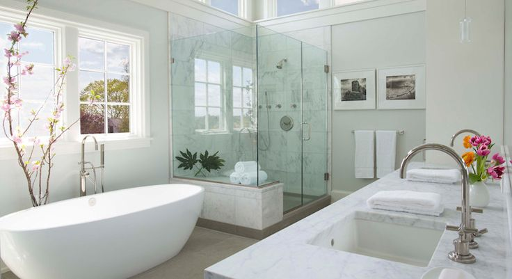 Spa like bathroom features an egg shaped bathtub adorned with cherry blossom and paired with a ...