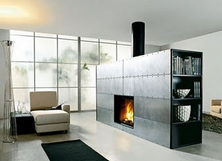 Modern fireplace with books and vases