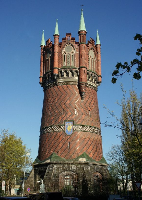 Rostock Water Tower in Rostock, Germany - photo by wolfro54, via Flickr, on The World Geography; Built in 1903, it is 197 feet high with a diameter of 59 feet at the base. It is made of bricks in a pattern with seven stepped gables and blind windows. It has been out of service since 1959. It is now a historic building and city museum warehouse. The ground floor is used for meetings.