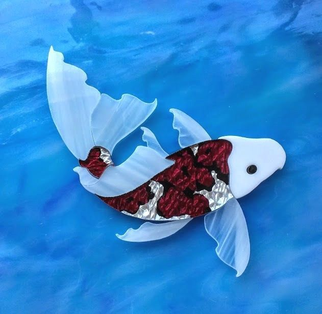 17 best images about mosaic pre cut stained glass on for Koi fish pool table