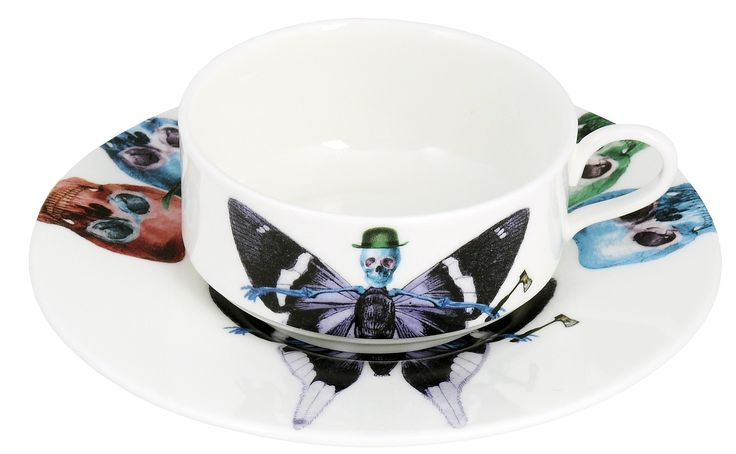 'Vis' Mocha Cup & Saucer taken from the 'Lepidoptera' range designed by Maxim from The Prodigy. Based on imagery drawn from his wonderful paintings, this range features an array of unusual creatures.  Butterfly design on cup continues onto saucer. Saucer also features edgy skulls taken from each six designs. Rear of mocha cup features a 22kt gold butterfly detail. Fine Bone China. Made in Stoke-on-Trent, England.