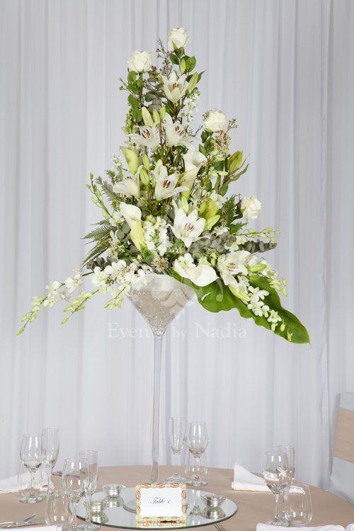Flower Arrange In Large Martini Glasses We Offer Wholesale Glass CenterpieceGlass CenterpiecesWedding