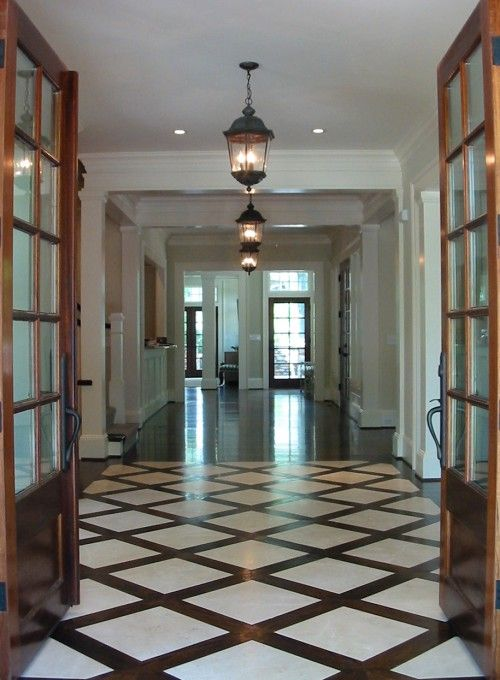 Dresser homes chic elegant foyer entrance design with for Entrance foyer tiles