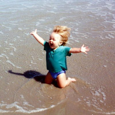 OMG, the joy on his little face! This is how I feel when I'm at the beach too. :)
