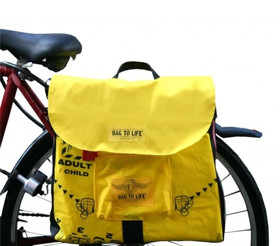 This luxury upcycled bicycle pannier bag protects the rider and the bag's contents against all the hazards of everyday cycling. Made from discarde ...