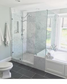 One of my favorite places to be! Our master bathroom shower. I do my best thinking and singing in here! My husband and I tore the wall down that was around the old shower to open up the space. I used Sherwin Williams Sea-salt and lots of carrera marble to create a clean, relaxing  spa like feel. Lots of white fluffy towels and his and her bathrobes makes me feel like I'm on a perma vacation!  #masterbathroom #marble #herringbone #spalike #whitefarmhouse #decorating #decor #bath #homedesign…