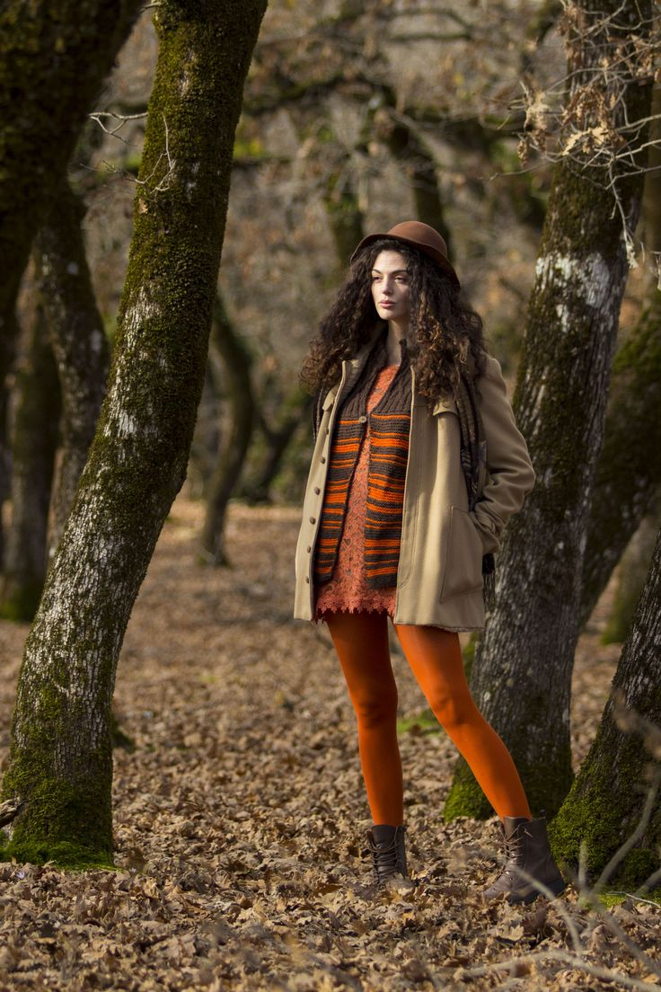 Orange outfit. Hat touch, knitted striped vest, orange dress and orange tights