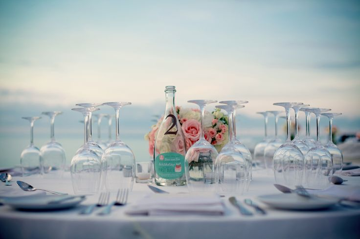 Wine bottle table numbers with a little story about the couple! Thanks to designer Li Sia Tan!!