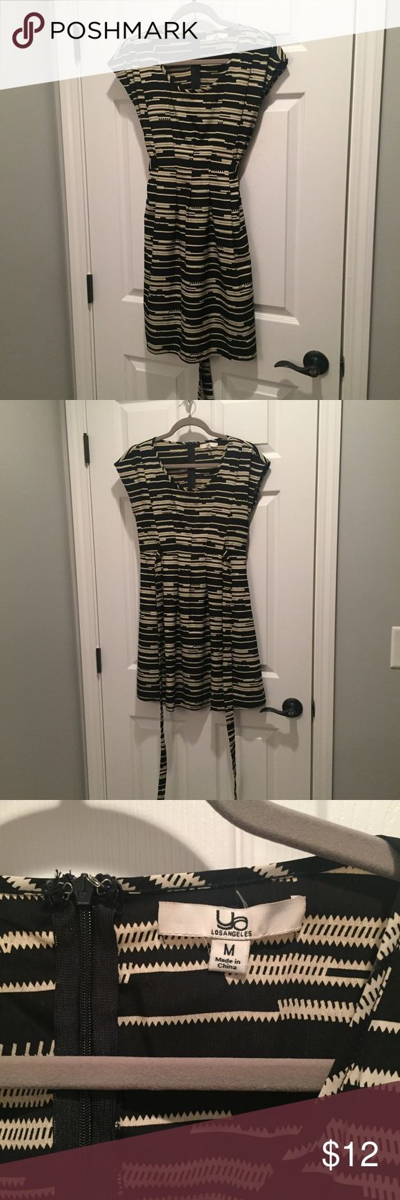 Boutique dress Boutique dress- black with tan aztec print. ties in back, cap sleeves, flattering a-line fit, excellent used condition - purchased from the boutique shop at Vanderbilt Children's Hospital Ya Los Angeles Dresses