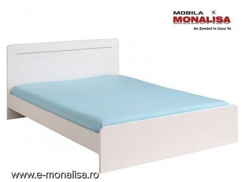 Paturide dormitor Albe  Myriad  Alegerea culorilor in dormitor este esentiala pentru un somn odihnitor.  O amenajare in culori luminoase a dormitorului maximizeaza confortul in clipele de odihna iar o mobila de dormitorcu pat albsporeste senzatia de eleganta si bun gust.  Pat de dormitor Alb Lucios Myriad  Paturile albedin gama Myriadsunt disponibile in dimensiune pentru saltea de 160cm x 200cm, dimensiuni optime pentru un pat matrimonial de dormitor.  Cadrul gratios curbat al…