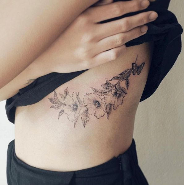 Blackwork florals on rib cage by Sol Tattoo