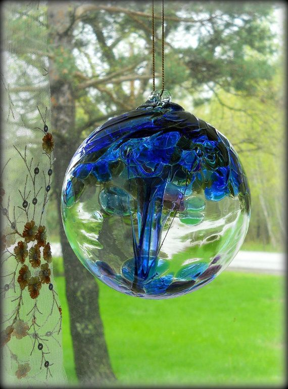 Salem  Witch Ball - Dating back to the 18th Century, hollow glass balls have been hung to ward off witch's spells and evil spirits.  Legend has it that the evil spirit is attracted to these colorful balls, pulled inside, and trapped within the glass web protecting the home from harm.