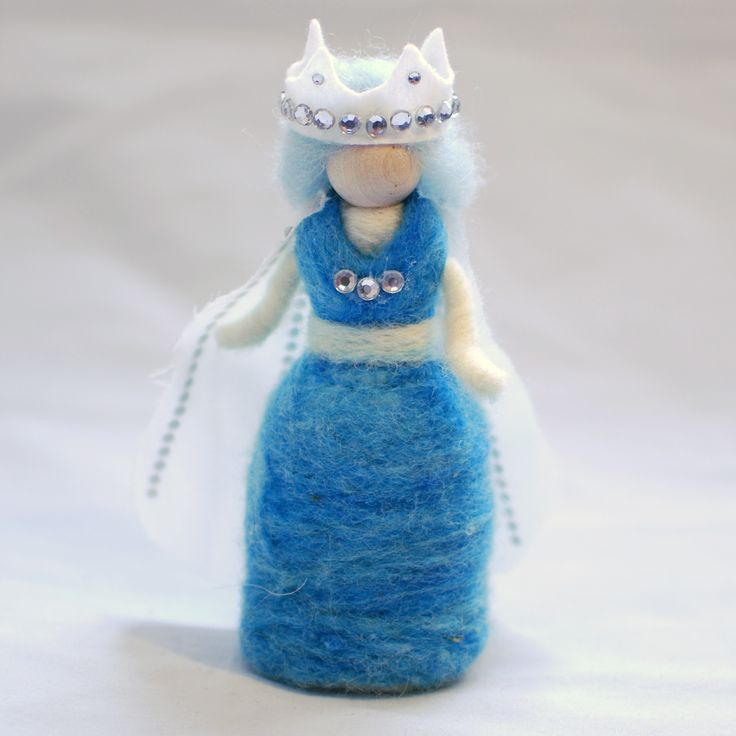 This needle felted fairy doll is about 5″ high.