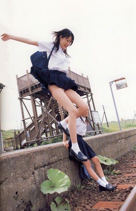 Schoolgirls jumping around