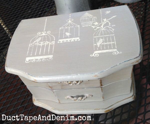 Top of jewelry box.  Painted with CeCe Caldwell's Seattle Mist, stenciled in Vintage White. | http://DuctTapeAndDenim.com