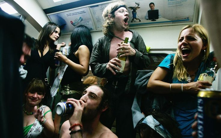 31 May 2008: Revellers enjoy one last drink on the London Underground during a cocktail party organised on Facebook. A ban on drinking alcohol on the tube was introduced on 1 June by Boris Johnson, the new Mayor of London.