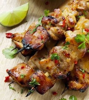 Cilantro Chili Chicken Skewers. Olive oil, garlic, cilantro in a food processor. Pour marinade over chicken cut into cubes. Marinate overnight if possible. Grill on skewers. Brush with sweet chili sauce just before taking off the grill.