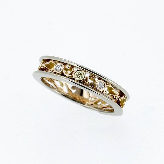 White and yellow gold filigree ring with canary yellow and white diamondsby TorkkeliJewellery