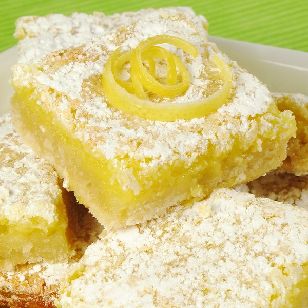 Light refreshing delicious lemon bars will disappear off the serving plate.