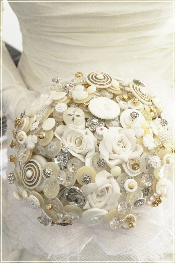 Big Day Decor: Take a different approach to your wedding flowers and choose... buttons? Different but cute! #quirky