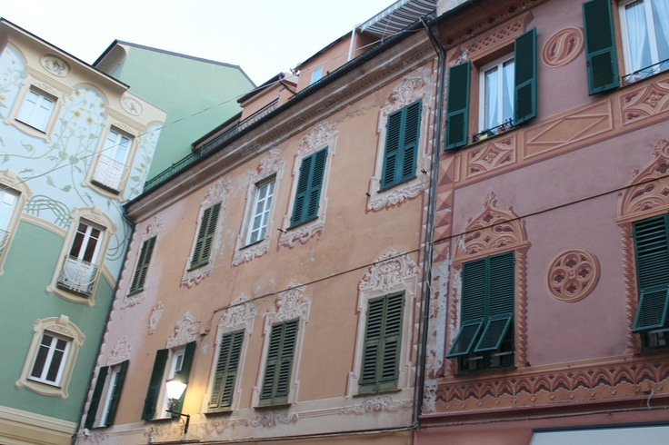 Pastel coloured houses in the medieval center of Loano.