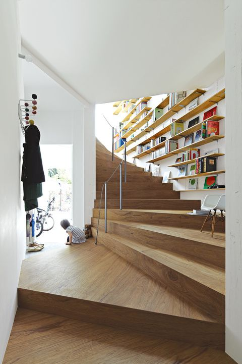 lovely sweeping super wide wooden stairs. interesting with the banister /railing down their center