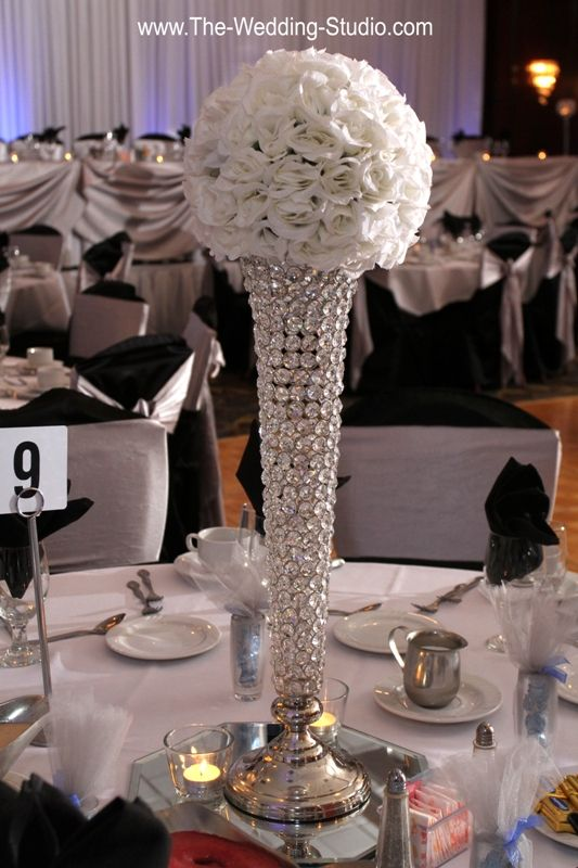 Lots Of Bling Sparkle Tall Vase Appearing To Be Made With Large Crystals Or Rhinestones Topped White Flowers Photographed By The Wedding