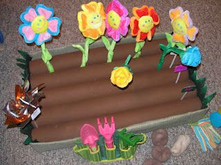 pretend garden for our dramatic play center  love how they used pool noodles wrapped in felt for the dirt