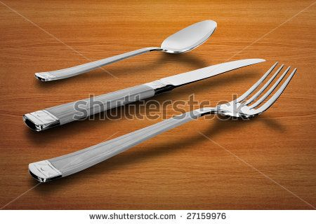 kitchen utensil. spoon and knife with fork over table