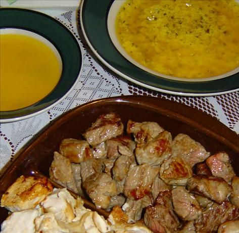 beef fondue with dipping sauces from Food.com: this is our traditional new years eve dish that i have been making for years. i also serve it with salsa and mango chutney, cornichons, boiled new potatoes.