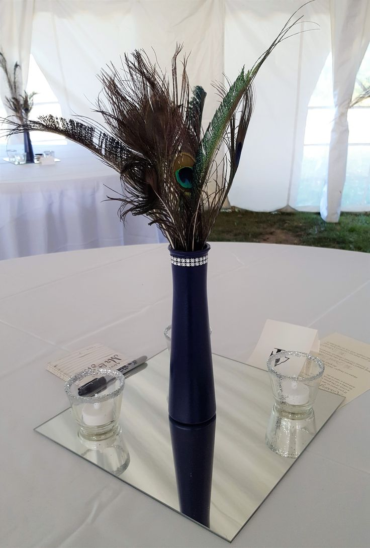 Proud peacock centerpieces at this elegant September 2017 wedding under a big tent set up on Ruthven Park's sprawling grounds.