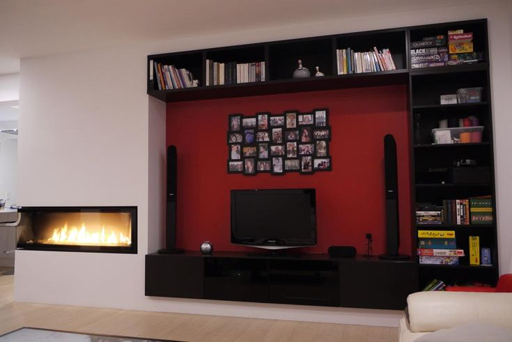 We wanted a TV unit which could be useful to store books/ children's games and also hide media devices. So we hacked a BESTÅ TV and storage unit