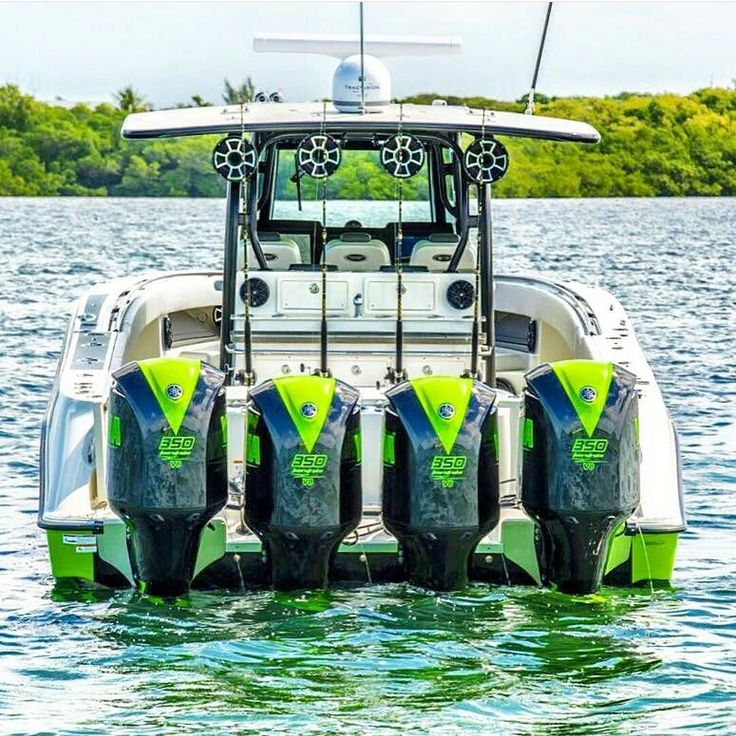 Great photo by @inletville - Lime green quad outboards on huge center console.